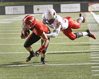 ROBERT K. YOSAY  | THE VINDICATOR..a#2 YSU  Bryan Christian is caught by #20Dominic Clarke for Illinois --took it to the 3 yard line  ist quarter  YSU vs Illinois State.. - -30-..