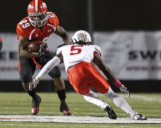 ROBERT K. YOSAY  | THE VINDICATOR..YSU  #29  Marin Ruiz  puts a move on #5 Tevin Allen  after gaining 17 yards and a first down..YSU vs Illinois State .. - -30-..