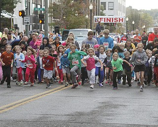 .          ROBERT  K. YOSAY | THE VINDICATOR..And they are off as the 400 m race downtown as the 10 and under runners leave central square running west on West Federal.....The 39th Annual Peace Race -  with over 2000 runners on a beautiful October day