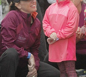 .          ROBERT  K. YOSAY | THE VINDICATOR..Pep talk --Madison Medvec 4, Struthers  gets some pre race advice from  Terri Hrina Treharn ( aunt).The 39th Annual Peace Race -  with over 2000 runners on a beautiful October day