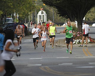 .          ROBERT  K. YOSAY | THE VINDICATOR..Runners head east on West Federal towards the finish line in central Square..The 39th Annual Peace Race -  with over 2000 runners on a beautiful October day