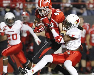ROBERT K. YOSAY  | THE VINDICATOR..YSU #44  Nate Adams  is corraled by Illinois State #5 Tevin Allen after a 27 yard pass and a first down - behind him is illinois #20 Dominic Clark..YSU vs Illinois State.. - -30-..