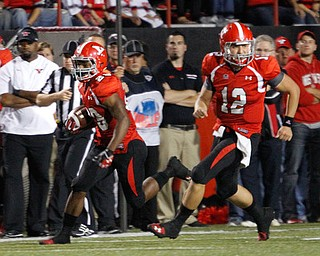 ROBERT K. YOSAY  | THE VINDICATOR..Number 29 YSU Martin Ruiz  after taking the latteral from #12 Kurt Hess - scampered for 7 yards and first down..YSU vs Illinois State.. - -30-..