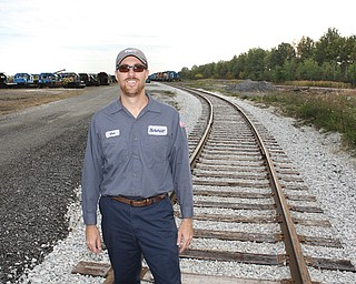 Matt McComber, operations manager at the Ohio Commerce Center in Lordstown for the company Savage, stands on some of the new train tracks that have been installed at the center.