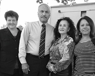SPECIAL TO THE VINDICATOR Hard at work preparing for the gala fundraiser planned by Hispanic American Civic and Cultural Organization are, from left, Susan Nieves, executive director; Hector Colon, event chairman; Minerva Colon, O.C.C.H.A. board president; and Dr. Consuelo Mendez, O.C.C.H.A. board member and event committee member.