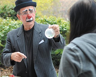 Jocko the Clown plays jokes on students as they wait in line at the Kilcawley Center at Youngstown State University Tuesday Morning.