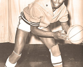 Vince Suber in a yearbook photo during his basketball playing days at Struthers High School. Suber will be among 13 individuals who will be inducted into the Ebony Lifeline All-Sports Hall of Fame today during the group's annual banquet. Suber also played baseball and football and ran track before attending Ohio State.