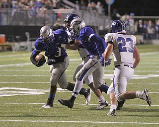 .          ROBERT  K. YOSAY | THE VINDICATOR..Hubbbards #3 LJ Scott drags  #6 Geno Petrus as Hubbards #1 Darnell Tate helps  #23  Poland  Adam Wollet  helped stop him before he scored\.. Poland Bulldogs @ Hubbard Eagles