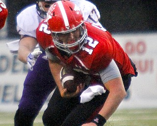 MADELYN P. HASTINGS | THE VINDICATOR..YSU's Kurt Hess (12) runs with the ball from Western Illinois' Kevin Kintzel (17) during Youngstown's homecoming game on October 19, 2013.... - -30-..
