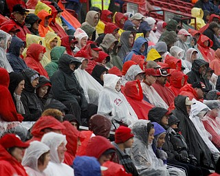 MADELYN P. HASTINGS | THE VINDICATOR..Visitors prepare for a rainy homecoming game at Stambaugh Stadium on October 19, 2013.... - -30-..