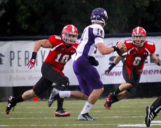 MADELYN P. HASTINGS | THE VINDICATOR..YSU's Ali Cheaib (10) and Donald D'Alesio (8) watch to tackle Western Illinois' Trenton Norvell (14) during Youngstown's homecoming game on October 19, 2013..... - -30-..