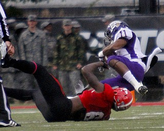 MADELYN P. HASTINGS | THE VINDICATOR..YSU's Travis Williams (6) brings down Western Illinois' Kyle Hammonds (11) during Youngstown's homecoming game on October 19, 2013.... - -30-..