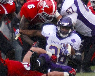 MADELYN P. HASTINGS | THE VINDICATOR..YSU's Travis Williams (6) and Kyle Sirl (33) tackle Western Illinois' J.C. Baker (38) during Youngstown's homecoming game on October 19, 2013.... - -30-..
