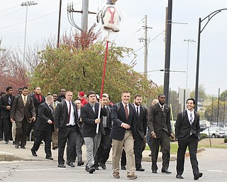 The Youngstown State football team crosses Fifth ave. after walking through the tailgate lots before the start of the Homecoming parade on Saturday.  Dustin Livesay  |  The Vindicator 10/19/13  Youngstown.