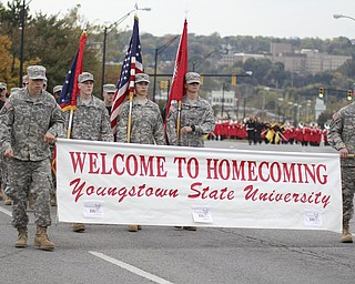 Members of the Youngstown State ROTC carry the homecoming banner at the start Homcoming parade on Saturday afternoon.  Dustin Livesay  |  The Vindicator 10/19/13  Youngstown.