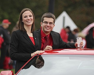 Youngstown State Student Governent representatives Catey Carney (left) and Michael Slavens ride in a car during the Homecoming parade on Fifth Ave. in Youngstown on Saturday. Dustin Livesay  |  The Vindicator 10/19/13  Youngstown.