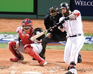 Cardinals catcher Yadier Molina and home plate umpire John Hirschbeck of Poland watch as the Red Sox's Mike Napoli connects for a three-run double in the first inning of Game 1 of World Series on Wednesday at Fenway Park in Boston. The Red Sox routed the Cardinals, 8-1, to take a one-game lead in the series.