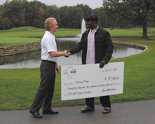 SPECIAL TO THE VINDICATOR Jim Whetstone, left, owner of Toyota of Warren, recently presented a check for $75,488.64 to Deryck Toles, executive director of Inspiring Minds. The proceeds were earned at the second annual Celebrity Golf Outing in June at Avalon Lakes in Warren. Toles founded Inspiring Minds seven years ago to inspire and empower young people to overcome obstacles in their lives. More than 200 have enrolled in its summer enrichment program.