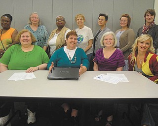 SPECIAL TO THE VINDICATOR The League of Women Voters of Greater Youngstown recently announced its officers and directors for 2013-2014. Above, seated from left, are Anne Harpman, second vice president and newsletter; Kathleen Dragoman, president; Dorothy Kane, secretary; and Michele Simonelli, first vice president; in back are Gwendolyn Fish, director; Nancy Terlesky, Corlis Green, Norma Coe Anderson and Suzanne Barbati, directors; Molly Toth, diversity; and Sarah Lowry, director. Other officers are Karen Lazarus, treasurer; Barbara Brothers, voter information guide; Marilyn Harrison, webmaster; Stephanie Danes-Smith, membership; and Roselyn Gadd, publicity. The next meeting will include a suffragette program Monday at the Tyler History Center in Youngstown. Meetings and publications are free. For information visit www.lwvgy.org.
