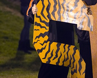 """Kelli Cardinal/The Vindicator .Anngel (ok) Allen, a sophomore at Springfield, holds up an """"S"""" in support of the Tigers during their game Friday night against South Range at Memorial Field in North Lima."""