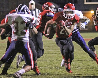 Luke Witkowski (27) of Struthers picks up good blocking on Niles McKinley's Antonio Sollito (33) as he cuts through the Red Dragons defense during the first quarter of Friday nights matchup at Struthers High School.  Dustin Livesay  |  The Vindicator 10/25/13  Struthers High School.