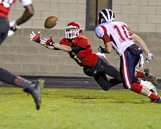 Dalton Moore (3) of Struthers stretches out in an attempt to catch a pass while being defended by Chris Parry (10) of Niles McKinley during the second quarter of Friday nights matchup at Struthers High School.  Dustin Livesay  |  The Vindicator 10/25/13  Struthers High School.
