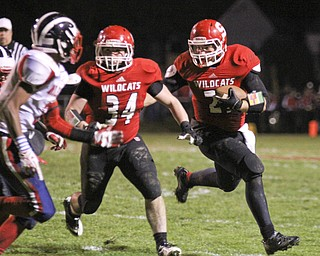 Nick Pollifrone (21) of Struthers picks up a block by Jay King (34) to get the corner on the Niles McKinley defense during the second quarter of Friday nights matchup at Struthers High School.  Dustin Livesay  |  The Vindicator 10/25/13  Struthers High School.