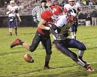 Marcus Donnadio (20) of Struthers forces a fumble by Corey Hayes (36) of Nile McKinley to stall a late second quarter drive keeping a Wildcat lead at halftime of 21-7 during the second quarter of Friday nights matchup at Struthers High School.  Dustin Livesay  |  The Vindicator 10/25/13  Struthers High School..