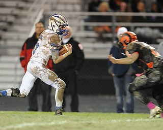 Reserve receiver #5 Danny Rosati runs in the open field before being tackled by Ridge #2 Jonathan Baker.