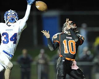 Ridge #10 Michael Eaton prepares to catch a touchdown pass over Reserve defensive back #34 Josh Vuletich.