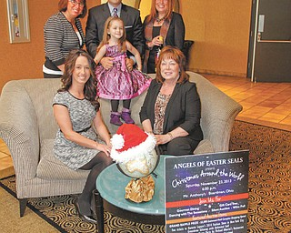 ROBERT K. YOSAY | THE VINDICATOR Angels of Easter Seals is preparing for the 27th annual Magic of the Angels' Christmas benefit set for Nov. 23 at Mr. Anthony's in Boardman. In front, from left, are Christa Blasko, marketing director of Eastwood Mall; Cyprus Blosser, child representative; and Kathy Carroll, president. Standing are Shelly LaBerto, co-chair; Mike Case, master of ceremonies; and Carolyn Leetch, co-chair.