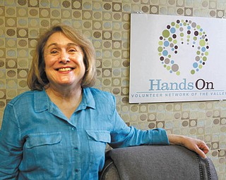 ROBERT K. YOSAY | THE VINDICATOR: Carol Ross of Boardman makes weekly calls to about a dozen elderly people as part of the Telephone Reassurance Program of HandsOn Volunteer Network of the Valley.