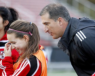 MADELYN P. HASTINGS | THE VINDICATOR..Canfield boys and girls soccer coach Phil Simone talks with sophomore player Haylee Klacik during practice on October 28. Both teams are competing in regionals this week.... - -30-..