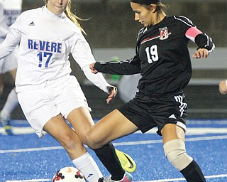 Canfield's Paige Bidinotto (19) and Richfield Revere's Hailee Zendlo (17) battle for control of the ball during a Division II regional semifinal Tuesday night in Ravenna. Canfield won, 4-3, in overtime.