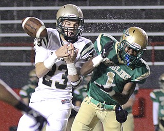 William D LEwis The Vindicator Ursuline's Ben Phillips(1) losses control of a pass while  SVSM's Nathan Bischof(23) defends during 1rst qtr action Thursday 10-31-13 at YSU.