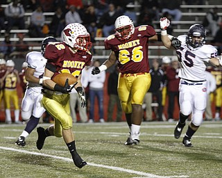 .          ROBERT  K. YOSAY | THE VINDICATOR..#22 Mooney  Mark Handel takes off for the sidelines and a gain as mooneys #66 Ted Everett holds back #5 Fitch KerrrellJohnson..Austintown Fitch @ Mooney at Stambaugh Stadium