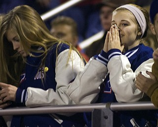 Kelli Cardinal/The Vindicator .Sabrina Miller, a junior at Western Reserve, watches the second quarter Friday night against Wellsville defenders on the Blue Devils field in Berlin Center.