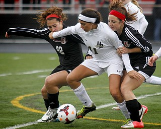 MADELYN P. HASTINGS | THE VINDICATOR..Canfield's Anita Mancini (22) and Sophia Mancini (12) fight for the ball against Hathaway Brown's Sabrina Kunimoto (41) during their game at Brecksville-Broadview Heights High School on November 2, 2013. ... - -30-..