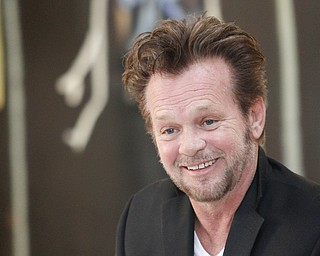 MADELYN P. HASTINGS | THE VINDICATOR..John Mellencamp discusses his painting during a reception to mark the opening of his exhibition of paintings at the Butler Museum of Art in Howland on November 2, 2013. .... - -30-..