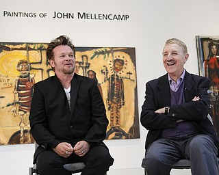 MADELYN P. HASTINGS | THE VINDICATOR..(L-R) John Mellencamp and director of Butler, Louis Zona, discusses Mellencamp's painting during a reception to mark the opening of his exhibition at the Butler Museum of Art in Howland on November 2, 2013. ... - -30-..
