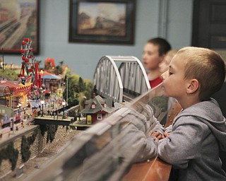 Alec Marcum (4) of Austintown looks at a train go in front of a model of Idora Park during the 2013 Youngstown Model Railroad Assosiation openhouse in Austintown on Saturday.  Dustin Livesay  |  The Vindicator  11/2/13  Austintown.