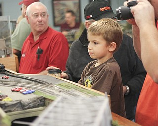 Karl Krol (4) of Lake Milton watches a trains go through a model of old steel mills during the 2013 Youngstown Model Railroad Assosiation openhouse in Austintown on Saturday.  Dustin Livesay  |  The Vindicator  11/2/13  Austintown.