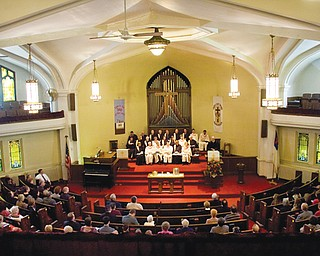 Congregation members listen to a sermon by the Rev. Peter Lawson during the dedication ceremony Sunday at John Knox Presbyterian Church on Market Street on Youngstown's South Side. The church is expected to close by the end of this month.