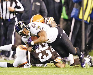 Ravens running back Ray Rice (2) is tackled by Browns cornerback Joe Haden (23) and inside linebacker Craig Robertson on the final play of the Browns' 24-18 win Sunday at Cleveland's FirstEnergy Stadium.