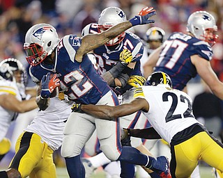 Patriots running back Stevan Ridley (22) tries to get away from Steelers cornerback William Gay (22) in the fourth quarter of Sunday's game in Foxborough, Mass. The Patriots won, 55-31.