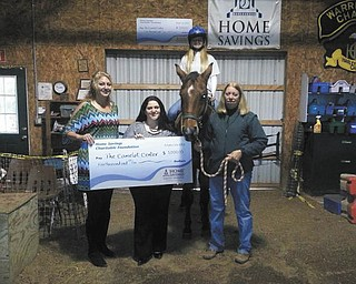 SPECIAL TO THE VINDICATOR Homes Savings Charitable Foundation has donated $5,000 to The Camelot Center for its capital improvement project. The nonprofit Southington center operates programs that use horseback riding as therapy for children and adults who have physical, mental, emotional and learning disabilities. From left are Nicolette Darkangelo, president of The Camelot Center; Traci Vigorito, retail manager of Home Savings' Howland office; Stephanie Maynard, student and volunteer, Camelot Center; and Debbie Meeker, director of Camelot.