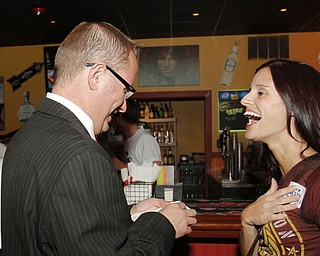 MADELYN P. HASTINGS I THE VINDICATOR..Jim Davis gives Maria Morales-Latone an election sticker during his election party at Jay Jay's Roadhouse on November 5, 2013.