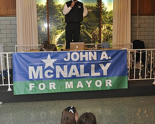ROBERT K. YOSAY  | THE VINDICATOR.. watching the winners Olivia Ciavarella 7 and Casey McNally 7 ( daughter ) John McNally  thanks his supporters after McNally won the Mayors race in Youngstown at Sts. Peter and Paul Ukrainian Church, on Belle Vista Ave., Youngstown...-30-....