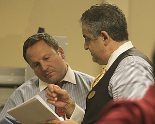 ROBERT K. YOSAY  | THE VINDICATOR..Mike Scortino and Dave Betras  talk over the results of the absentee ballots at the Board of Elections ..-30-....