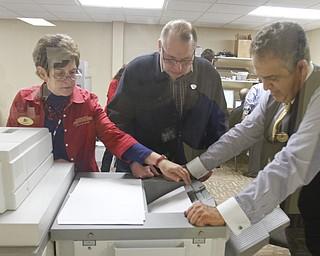 ROBERT K. YOSAY  | THE VINDICATOR..Joyce Kale Pesta - Bob Wasko and Dave Betras look over the absentee results at the Mahoning County Board of Elections..-30-....